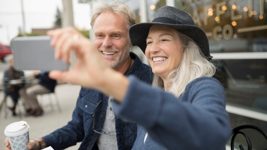 Older couple stopped to pose for a selfie